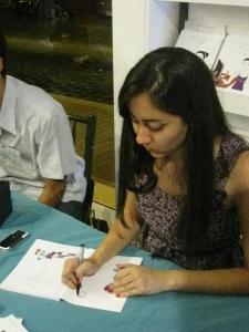 Maya Zankoul signing her book Amalgam